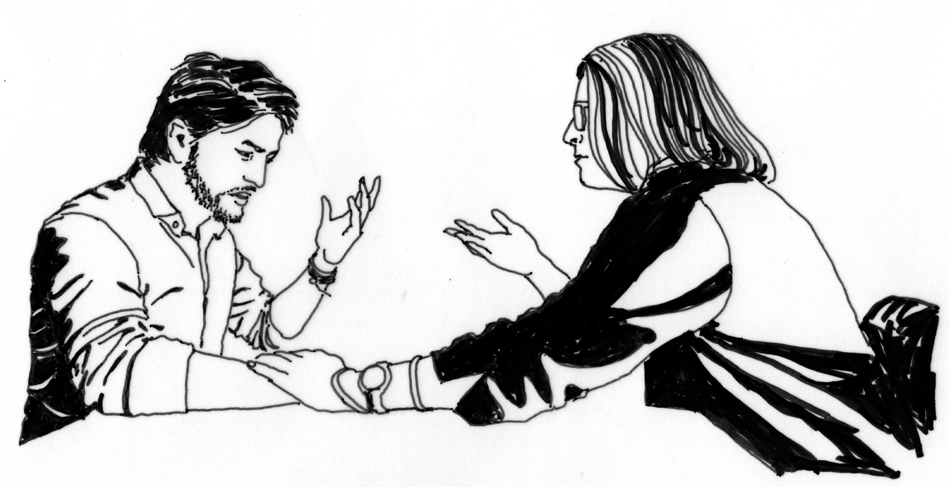 a man and a woman talking to each other at a meeting table