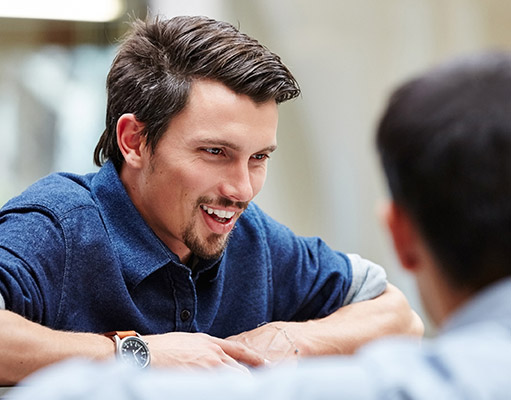 Man in a meeting smiling