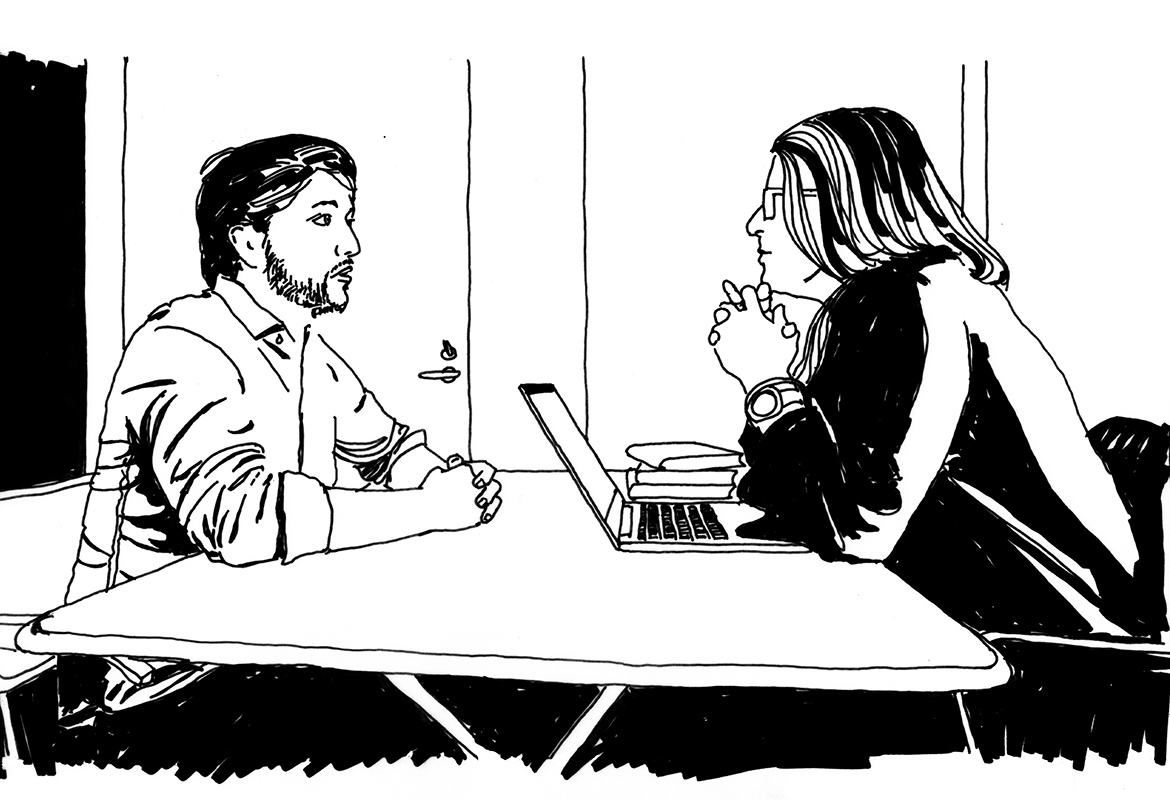Man and woman in conversation in an office.